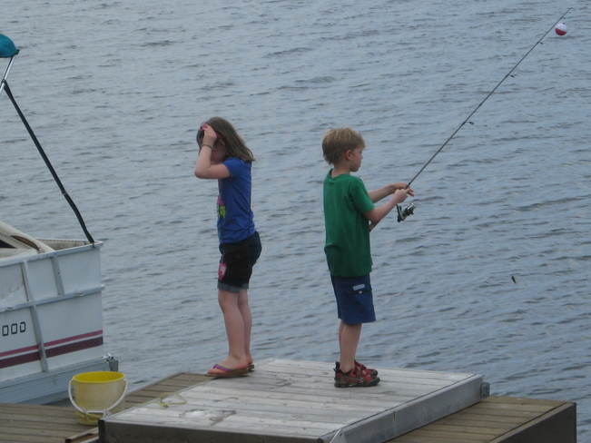 2 Friends Fishing Off The Dock at Mawn Lake Thunder Bay, ON