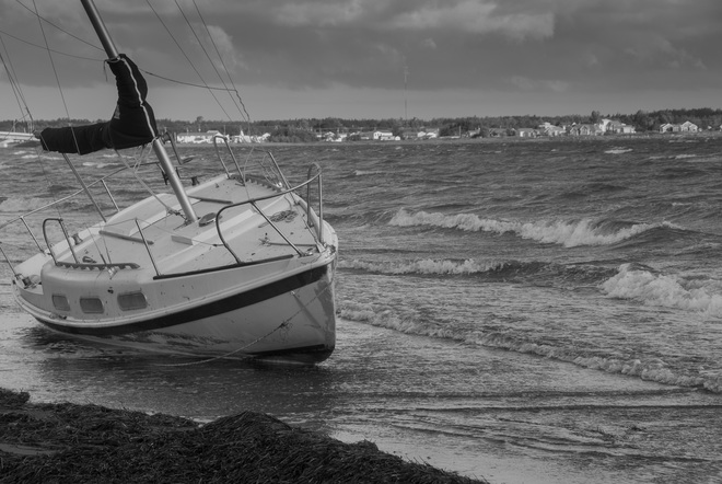 Sailboat on shore Cocagne, NB