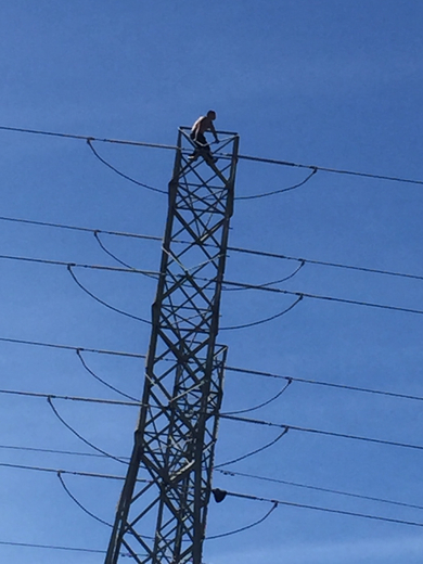 man refusing to come down from electricity tower