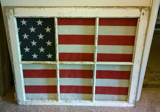 Old Flag in A Barn Window for Flag Day