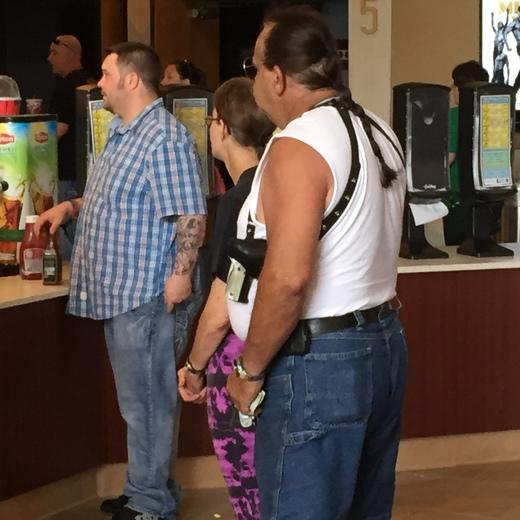 Gun carrying inside Copper Creak Theater in Pleasant Hill