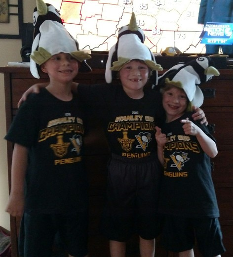 Triplets love the Penguins !