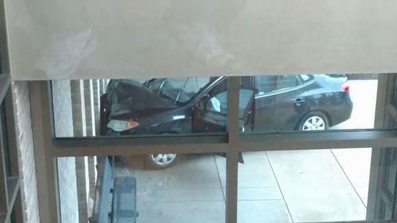 Car drives into cancer treatment center