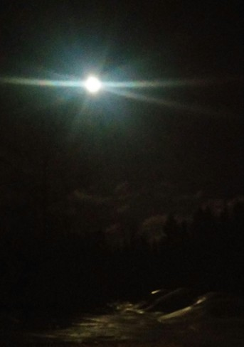 Full moon shing on the crusty snow at our camp. Miramichi, NB