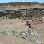 Ancient rocks on the beach at Cemaes Bay, Anglesey, N. Wales