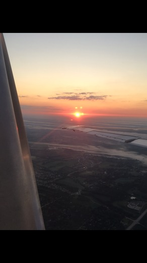 Omaha sunrise miles above the city