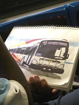 Artist on the Bus