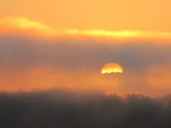 Beautiful sunrise through the thick morning fog