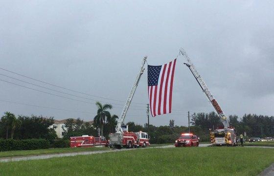 Giant Flag on Ladder Trucks