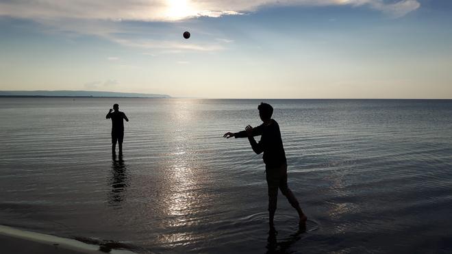 Throwing The Football At Wasaga Beach
