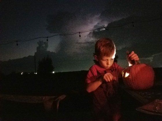 Carving pumpkins while watching the storms role in