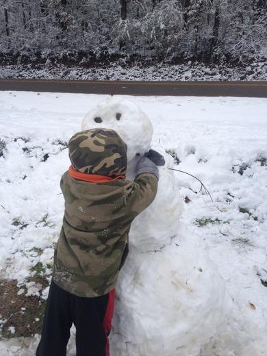Hugging snowman