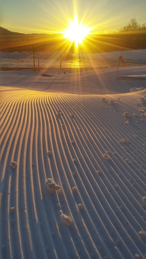 Corduroy snow at  sunrise Stowe Mountain.