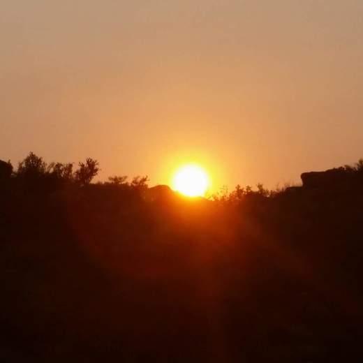 Sun peeking over the mountainside