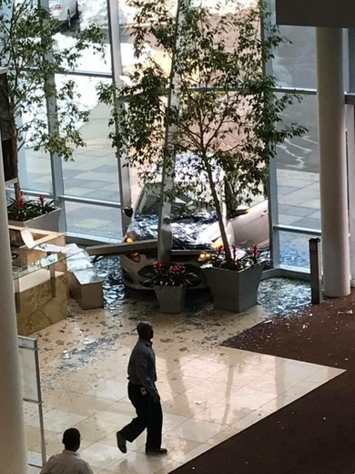 Car drove through front lobby at 930 Winter St Waltham.