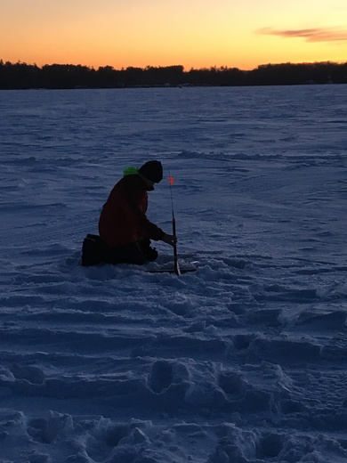 Hunter ice fishing