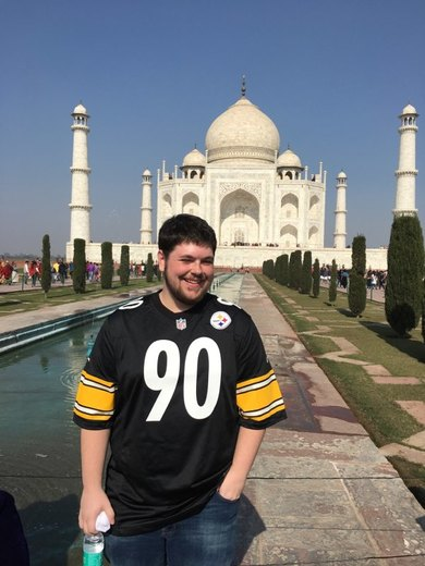 Steeler fan Eric Simon, from Allison Park in front of Taj Mahal