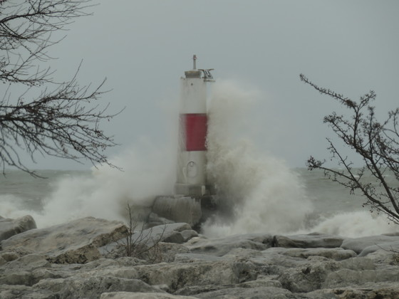 Waves crashing on the lighthouse in Kenosha