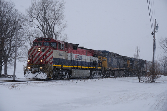 BCRAIL 4643 Leading CN M324-21 through Alburg VT in the snow