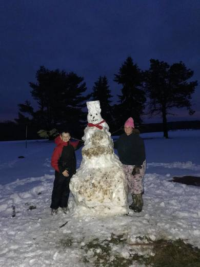 On our snow day we  built a  6.5 ft tall snowman !
