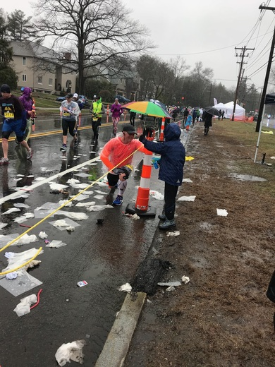 Ryan of West Newton lending a helping hand to a runner who had stopped to stretch.