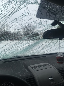 My wife's vehicle was stuck by ice on I-87 flying off of a truck