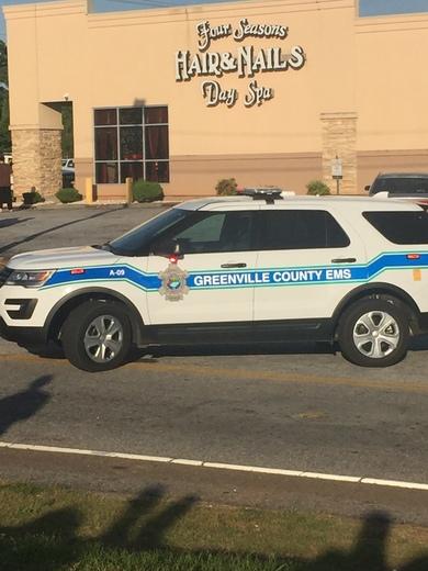 Coroner on scene of accident on Pleasantburg Drive