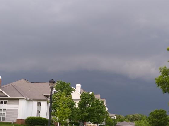 Small shelf cloud on leading edge of approaching storms.