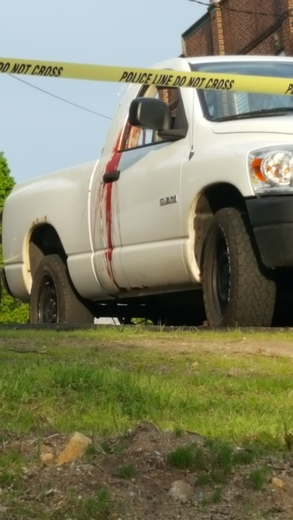 The white pick-up from the shooting with the blood
