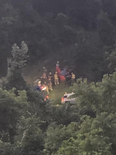 Riding lawnmower flipped in port Vue