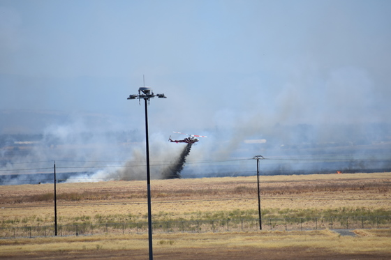 Helicopter Dropping Retardent On Grass Fire Near Sacramento International Airport