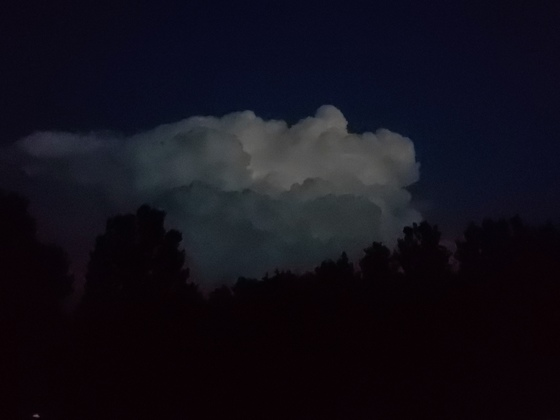 Lightning in a cloud on a clear, mostly,  night.