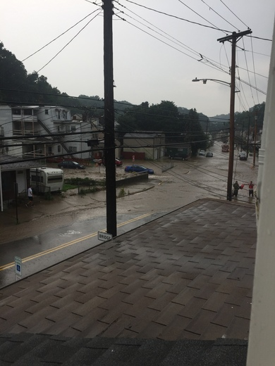Millvale flooding. This is North Ave at Frederick St. road closed.
