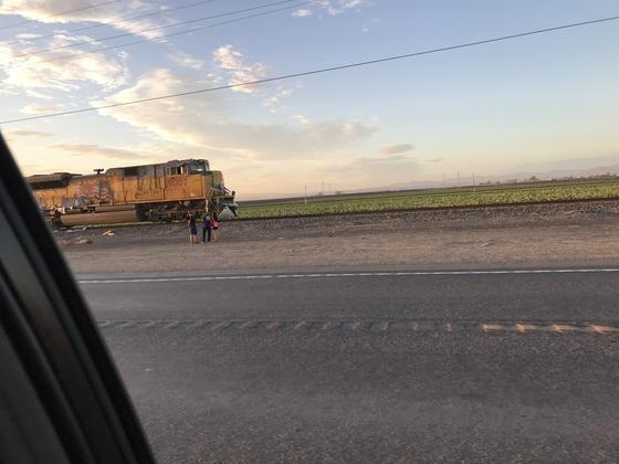 Semi truck crossed over rail road tracks