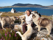 5b. Inuit elder playing with Labrador huskies