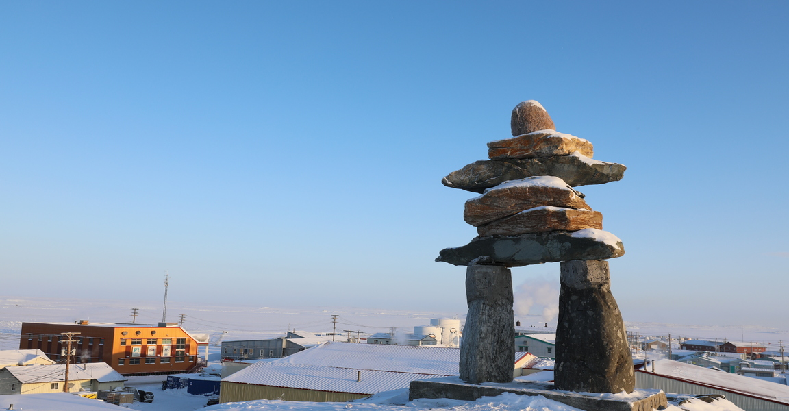 Inukshuk on the top of the hill in Rankin Inlet, Nunavut Canada