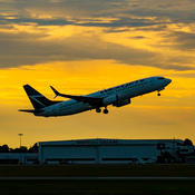 Westjet taking off into the sunset
