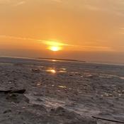 Coucher de soleil sur fleuve de glaces.