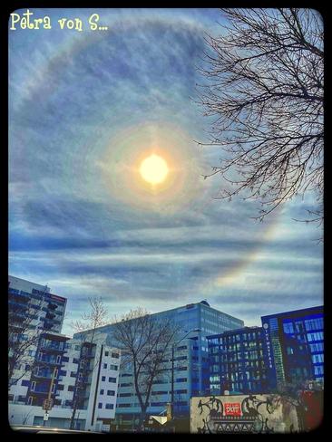 """""""Sundoggie """" setting sun in the downtown of Edmonton Edmonton, Alberta, CA"""