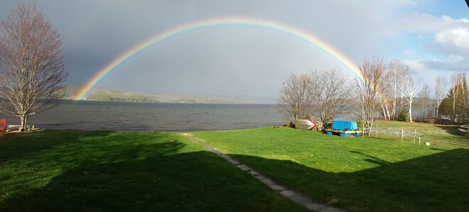Both ends of the rainbow on Papineau Lake Maple Leaf, Ontario