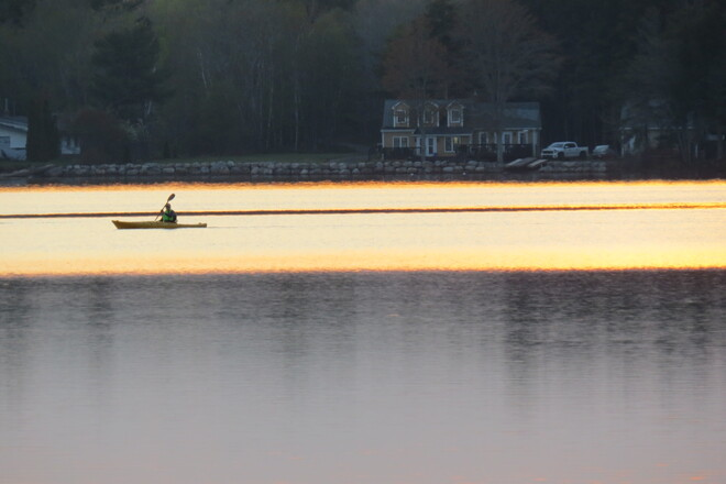 Sunset and boaters. Conquerall Mills, NS