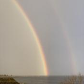 Thunder lightning Rain Double Rainbow Peach sky over the Atlantic Ocean