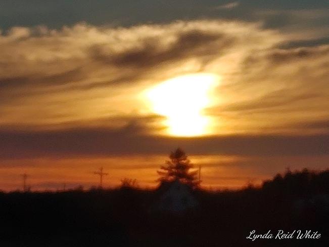 sun coming up Joggins, NS