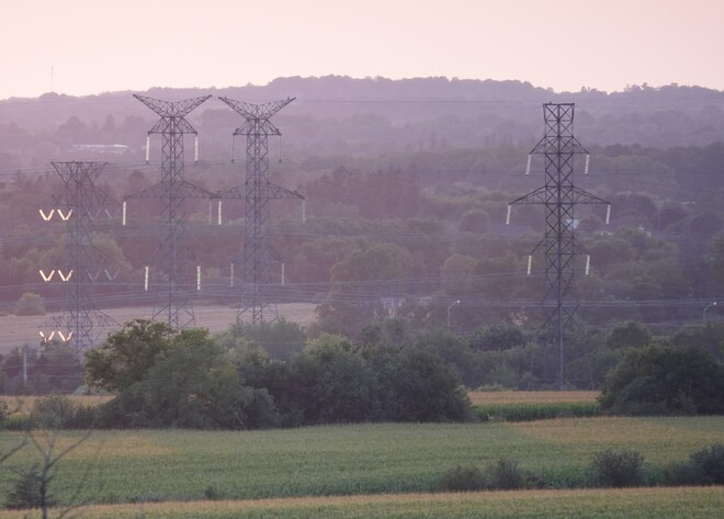 Cross country Hydro Tower line insulators glowing in the late day Sun North Oshawa, Ont.