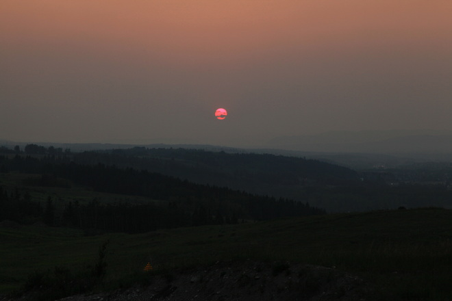 Sunset obscured by smoke Cochrane, AB