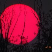 Smokey Sun Setting in West Sky