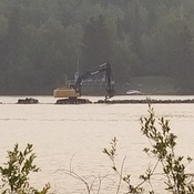 putting the brake wall back in the nipigon river across from the dock
