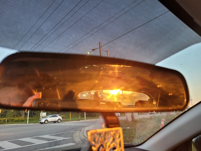 sunset in the rearview mirror London, ON