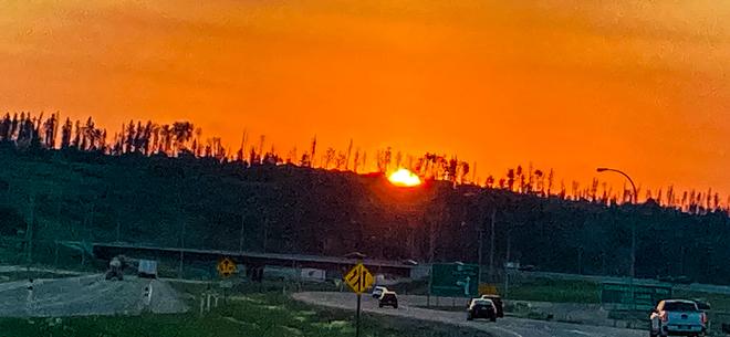 Sun setting Fort McMurray, Alberta, CA