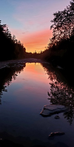 sunset reflecting in a puddle Massey Drive, NL
